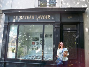 Courtney standing in front of Le Bateau-Lavoir where Modigliani and Picasso once lived and worked in an artist commune.