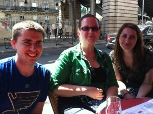 James, Courtney, and Courtney relax at a café